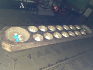 "An antique wooden board used to play ""sungka""."