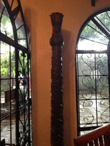 One of a pair of hand-carved wooden door posts at the main entrance.